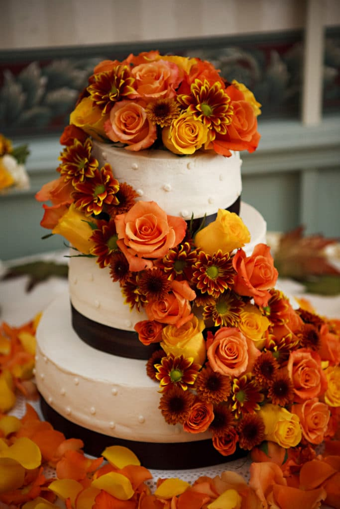 fall wedding cake covered in roses