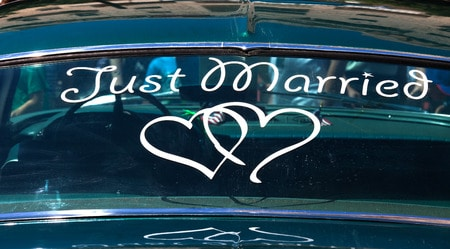 just married window cling sign on a car's back window