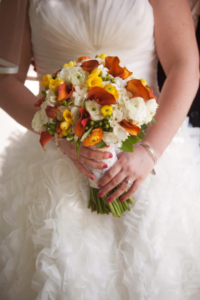 bride's bouquet with callas, ranunculus, and stephanotis