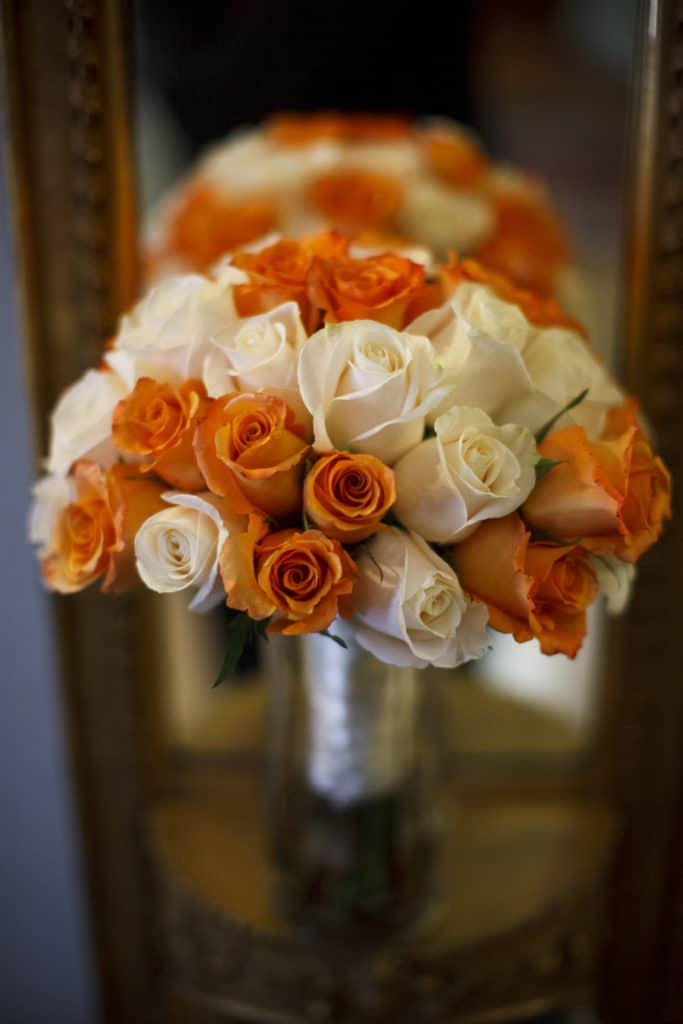 bride's bouquet with orange and white roses