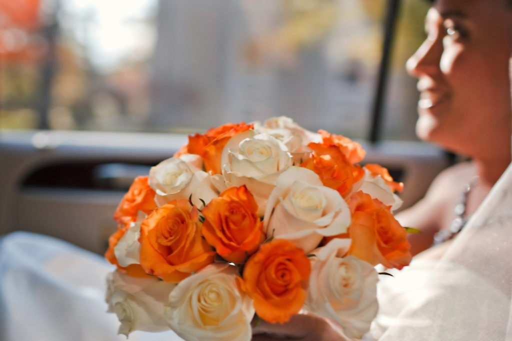 The meaning of flowers - Bridal bouquet of white roses (purity & innocence) and orange roses (passion)