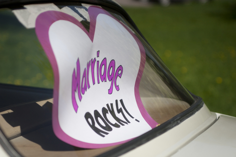 decorate newlyweds' car - marriage rocks sign