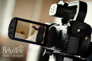 wedding video with bride and groom through video camera